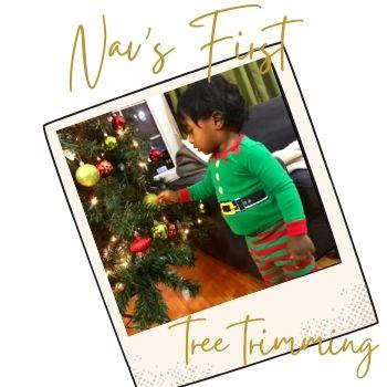 toddler boy decorating tree