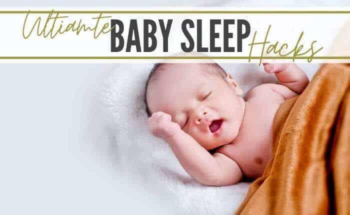 newborn sleeping in crib
