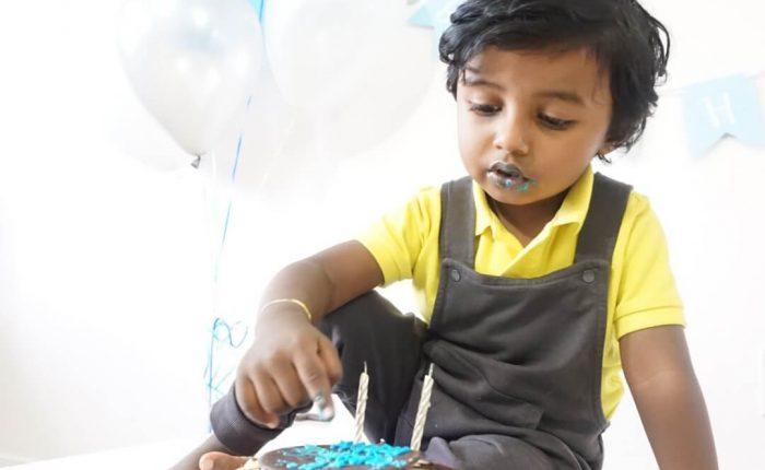 birthday boy eating birthday cake