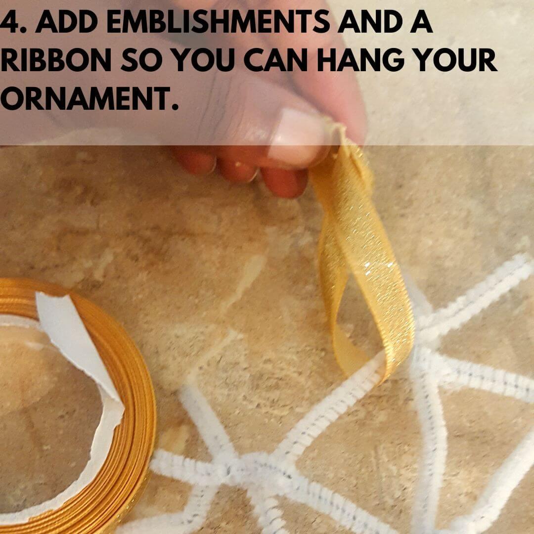 Tying a ribbon around DIY ornament craft.