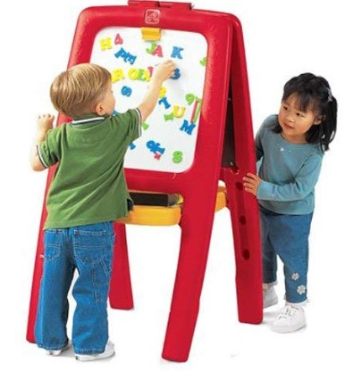 toddler boy and girl playing with magnetic easel