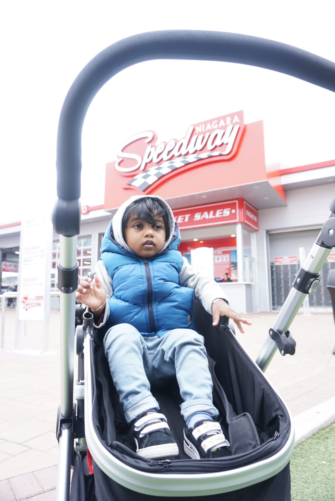 toddler boy watching races at the Niagara Falls Speed Way