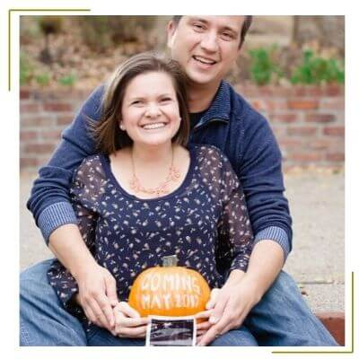 pregnant mom holding pumpkin to announce pregnancy