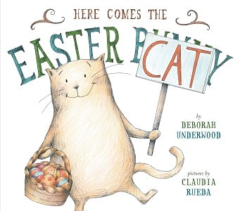 Here Comes the Easter Cat Book Cover with a cat holding a basket of Easter Eggs