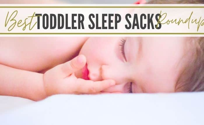toddler sleeping in wearable blanket with legs