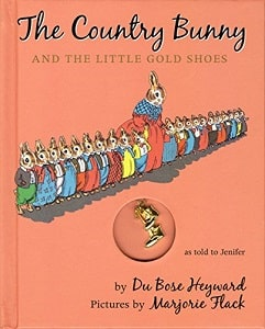 The country bunny and the little golden shoes book cover with mom bunny and many baby bunnies