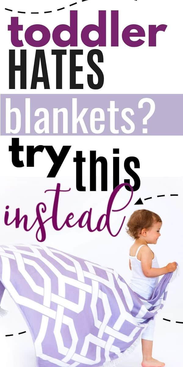 toddler holding wearable blanket