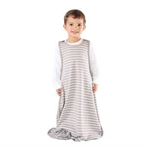 toddler boy wearing woolino toddler sleep sack