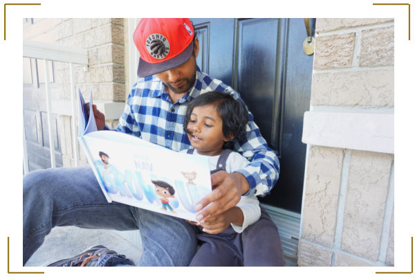 dad and son reading personalized father's day book Hooray Heroes